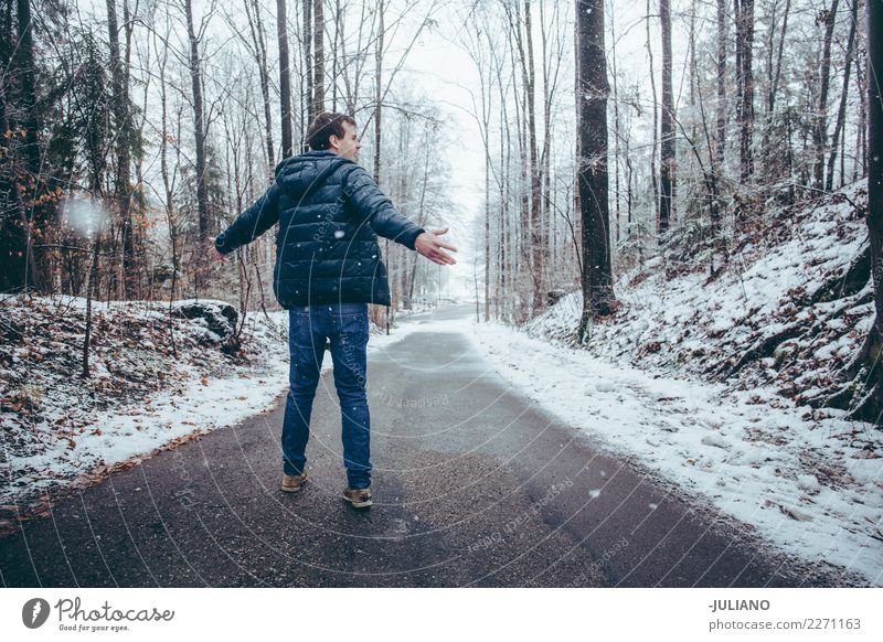 Young man is dancing in the snow Leisure and hobbies Far-off places Freedom Winter Snow Winter vacation 1 Human being 18 - 30 years Youth (Young adults) Adults