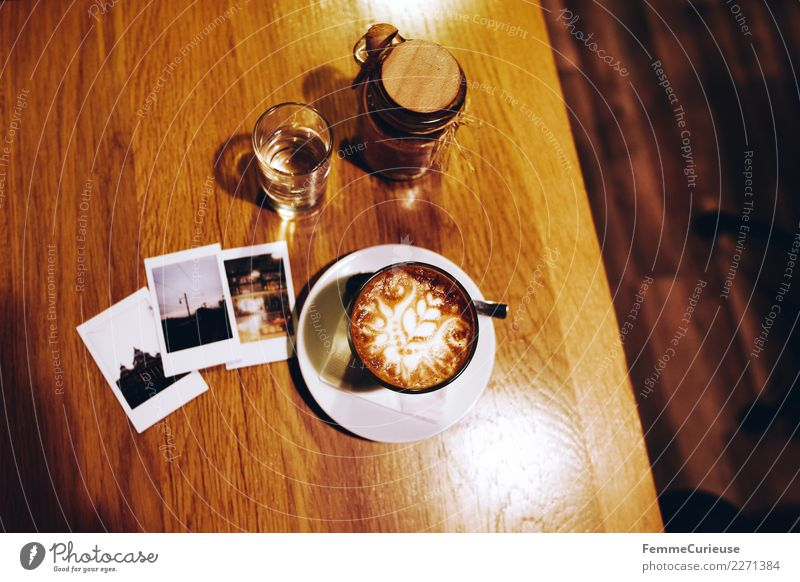Instant pictures and coffee on wooden table Breakfast To have a coffee Beverage Coffee Leisure and hobbies Coffee cup Cappuccino Instant camera Polaroid