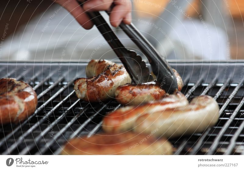 Bratwurst is grasped Food Sausage Gastronomy Hand Barbecue (apparatus) Brown Pair of pliers Take Grating Crust Roasted BBQ season Thuringia Colour photo
