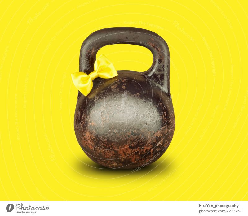Old kettlebell with yellow tied bow on yellow background Yellow Sports Health care Birthday Energy Fitness Easter Card Athletic Carnival Sports Training