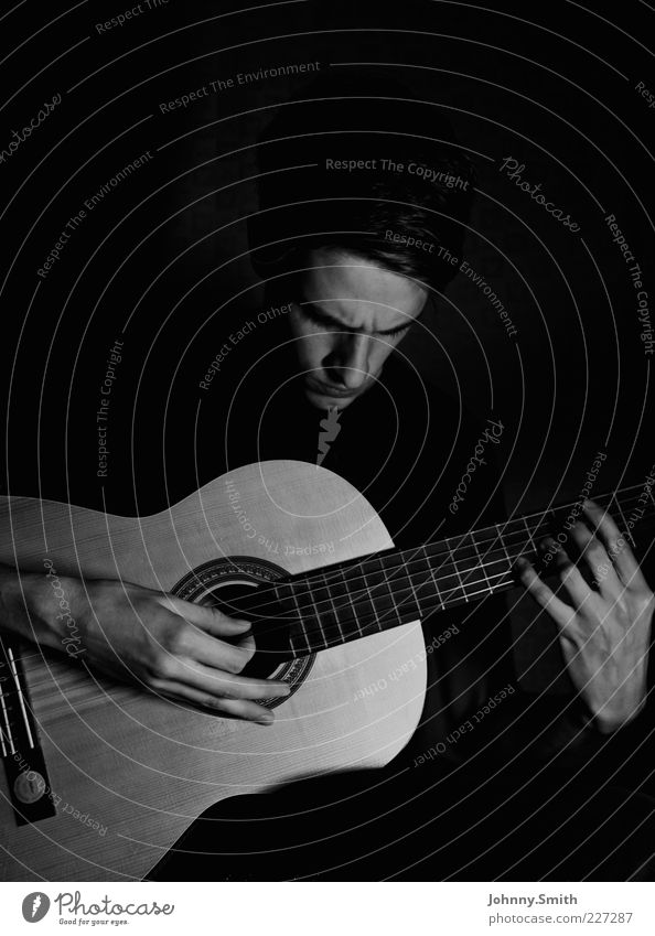 Me and my guitar. Leisure and hobbies Play guitar Human being Masculine 1 Artist Music Musician Guitar Playing Simple Passion Concentrate Black & white photo