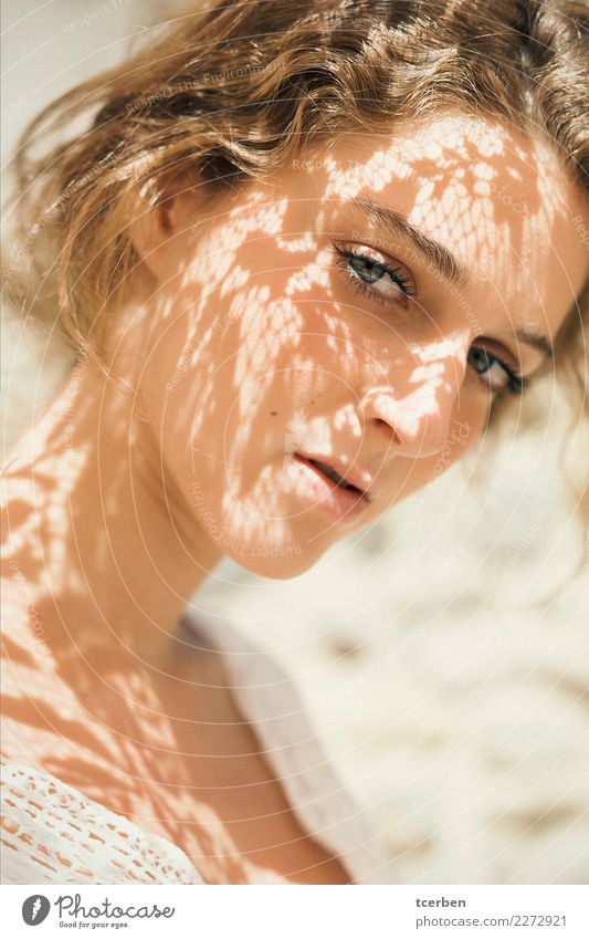 Pretty young woman with light and shadows on her face Human being Youth (Young adults) Young woman Beautiful White Relaxation Calm 18 - 30 years Eyes Adults