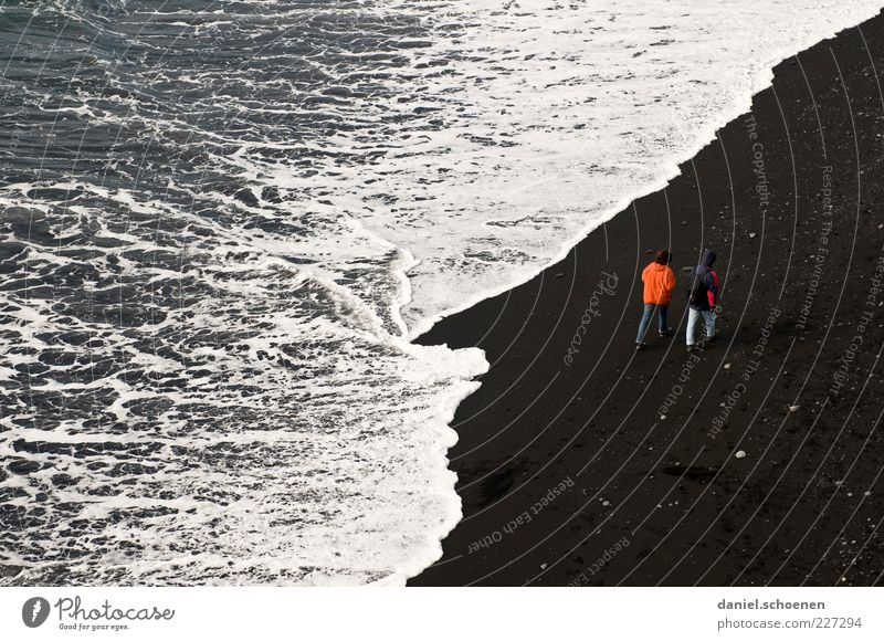 beach walk Vacation & Travel Tourism Beach Ocean Waves Masculine Couple Partner 2 Human being Coast Red Black White Together Relationship Iceland Lava beach