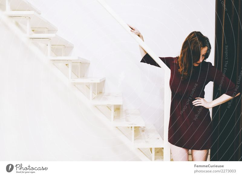 Woman in burgundy dress standing right on stairs Feminine Young woman Youth (Young adults) Adults 1 Human being 18 - 30 years Emotions Crisis Pain Withdrawn