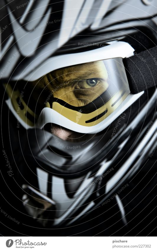 MX Leisure and hobbies Motorsports Masculine Observe Aggression Threat Cool (slang) Dark Athletic Anger Yellow Brave Helmet Motocross driver Colour photo