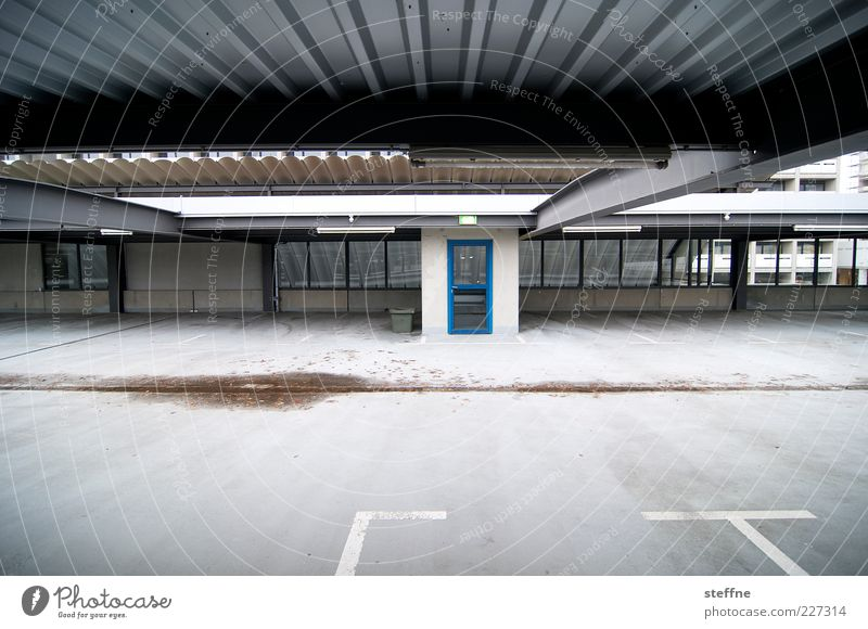 into the blue Door Town Empty Uninhabited Parking garage Colour photo Exterior shot Copy Space bottom Wide angle Lane markings Parking lot Corrugated sheet iron
