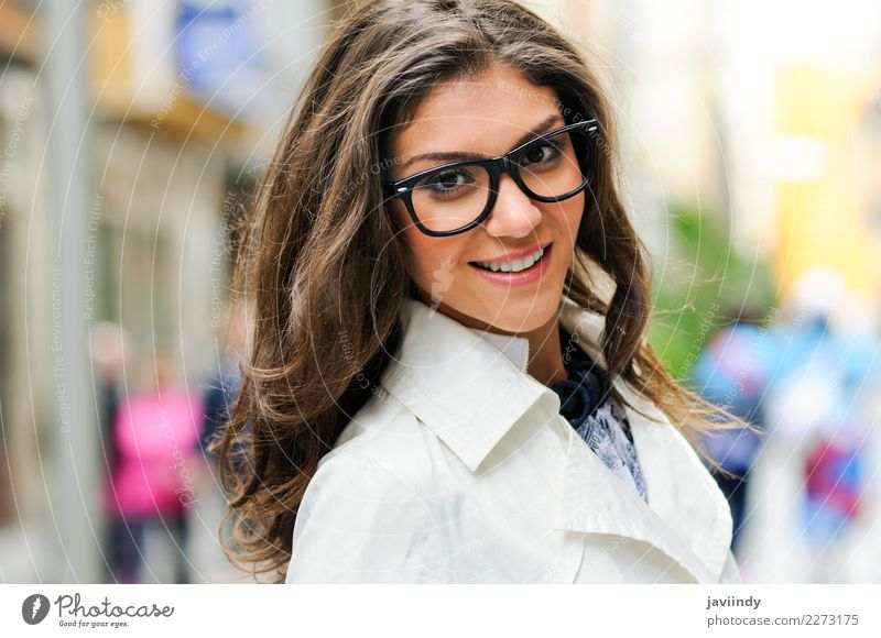 Young woman with eye glasses smiling in the street Lifestyle Beautiful Hair and hairstyles Face Calm Human being Feminine Youth (Young adults) Woman Adults