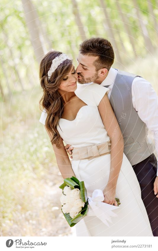 Just married couple together in poplar background Happy Beautiful Feasts & Celebrations Wedding Human being Young woman Youth (Young adults) Young man Woman