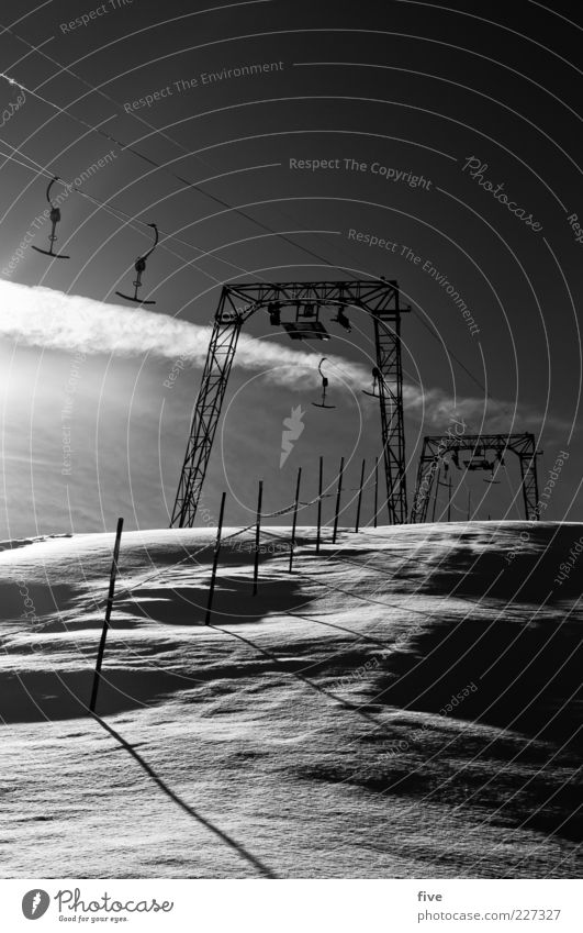tug Nature Sky Clouds Winter Weather Beautiful weather Ice Frost Snow Hill Alps Mountain Cold Ski tow Ski lift Pole Black & white photo Exterior shot Morning