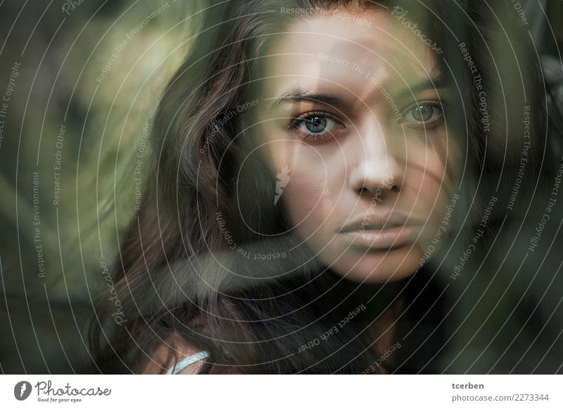Close-up portrait of a blue-eyed woman with shadows on her face Human being Youth (Young adults) Young woman Beautiful Green Loneliness Calm 18 - 30 years Eyes