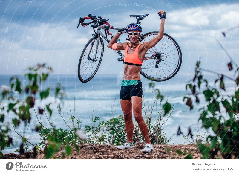 Triathlete woman with bicycle Human being Youth (Young adults) Young woman Adults Masculine Hiking Body Power Success Happiness Cycling Fitness Might Brave