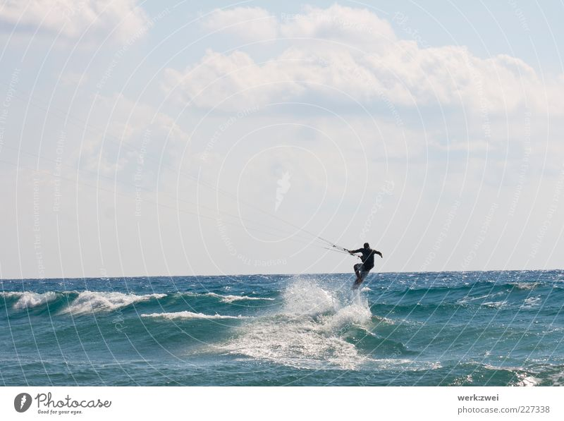surfing Aquatics Sportsperson Kiteboard Ocean Masculine 1 Human being Environment Water Drops of water Sky Clouds Horizon Sunlight Summer Beautiful weather