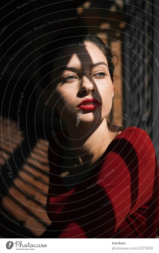 Portrait of pretty woman with red lips and shadow on her face Human being Youth (Young adults) Young woman Colour Beautiful Red Eroticism Loneliness Calm