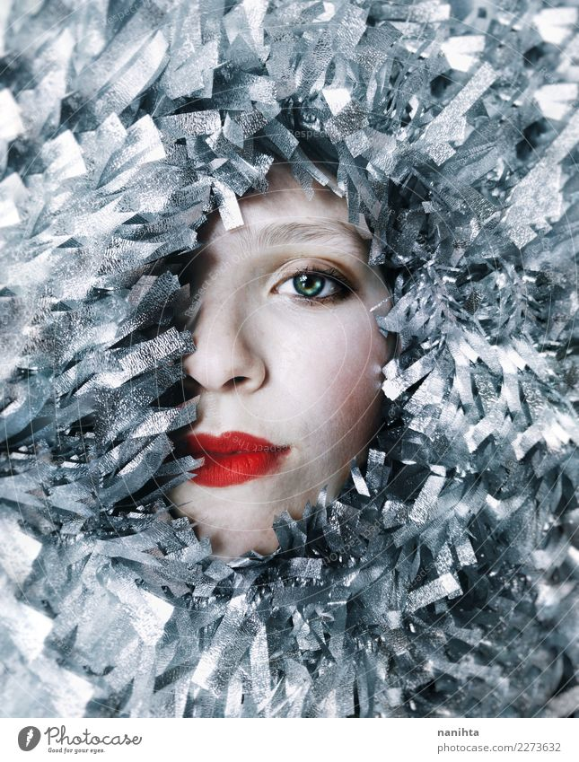 half face of a woman surrounded by silver garlands Human being Youth (Young adults) Christmas & Advent Young woman Beautiful White Red 18 - 30 years Face Adults