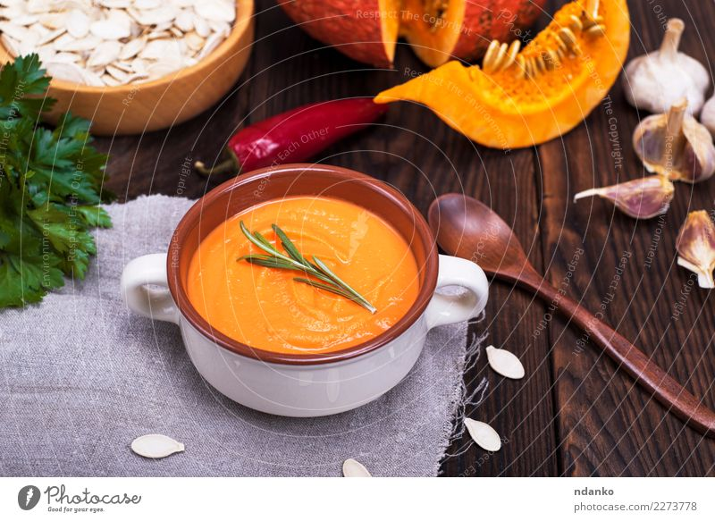 thick pumpkin soup Vegetable Soup Stew Herbs and spices Nutrition Eating Lunch Dinner Vegetarian diet Diet Bowl Spoon Decoration Table Kitchen Hallowe'en Nature