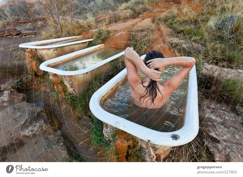 Young woman relaxing in a natural hot springs.. Human being Youth (Young adults) Beautiful Adults Relaxation Swimming & Bathing Lifestyle 18 - 30 years Bathtub