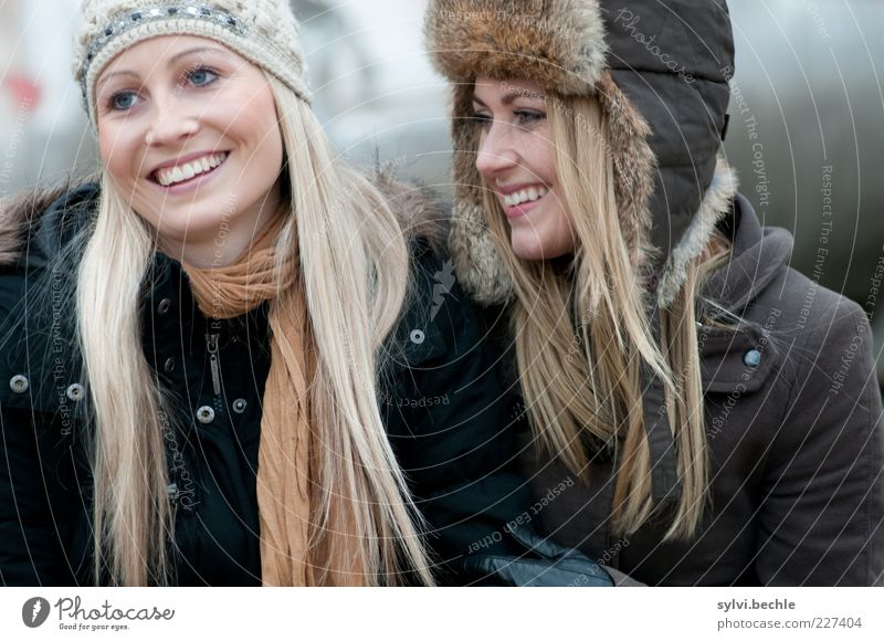 friends VI Human being Feminine Young woman Youth (Young adults) Friendship Life Hair and hairstyles Face 2 Jacket Coat Pelt Cap Touch Smiling Laughter Blonde