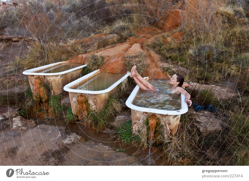 Young woman relaxing in a natural hot springs.. Human being Youth (Young adults) Adults Relaxation Swimming & Bathing Wet 18 - 30 years Bathtub Well-being Wash