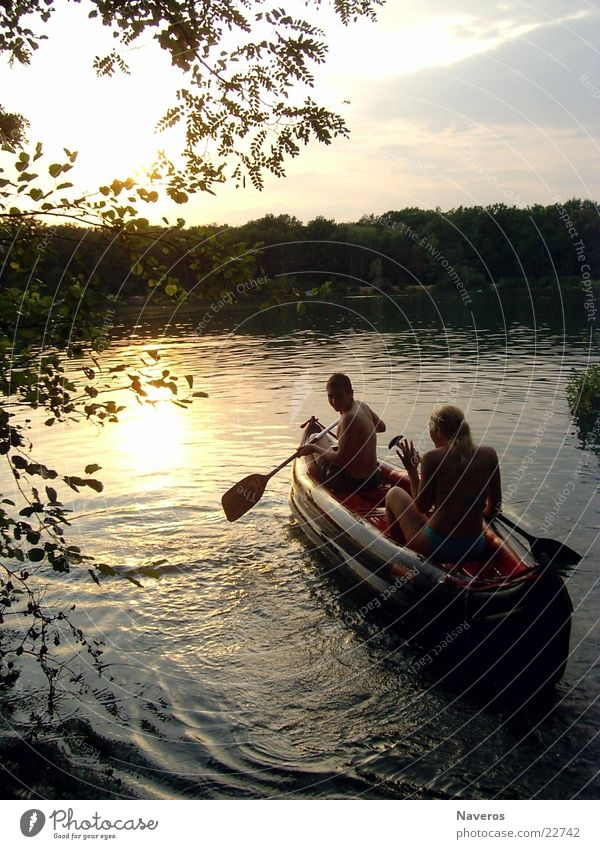 Human being Water Lake Watercraft Romance Navigation Rowing Evening sun Paddling Lake Baggersee Dinghy