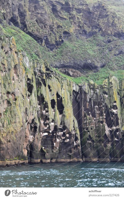Water Ocean Landscape Coast Rock Tall Wild Hollow Vertical Steep Fjord Volcano Cave Natural phenomenon Wall of rock Volcanic