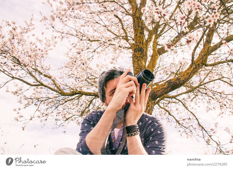 Young man taking photos in nature Human being Nature Vacation & Travel Youth (Young adults) Man Summer Beautiful Tree Flower Adults Life Lifestyle Environment