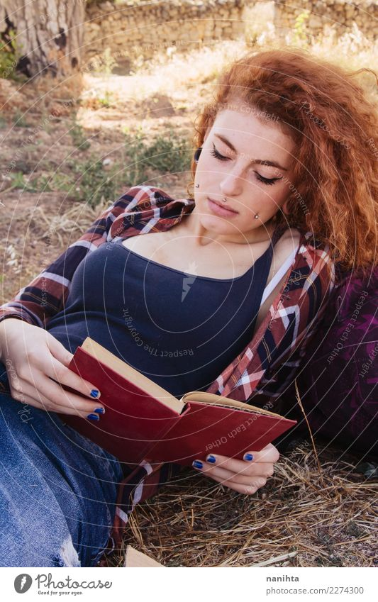 Young redhead woman reading a book Human being Nature Youth (Young adults) Young woman Summer Sun 18 - 30 years Adults Lifestyle Autumn Feminine Style