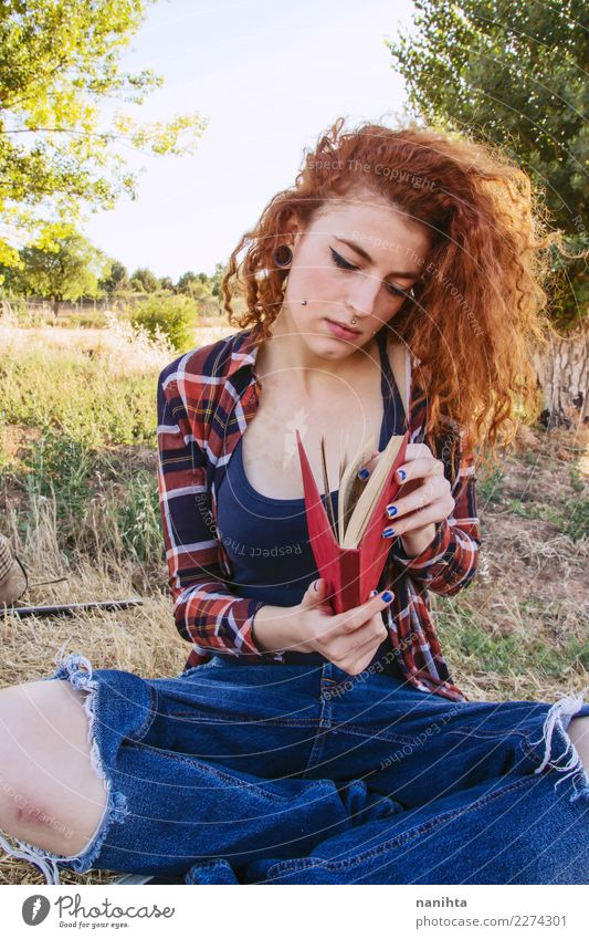 Young woman is opening a book, outdoors . Human being Nature Youth (Young adults) Beautiful Calm 18 - 30 years Adults Lifestyle Environment Feminine Art