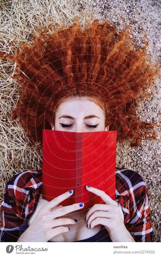 Young redhead woman reading a red book Human being Youth (Young adults) Young woman Beautiful Red Relaxation 18 - 30 years Adults Lifestyle Feminine Style Art