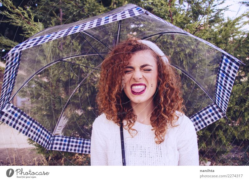 Young redhead woman sticking out her tongue in a rainy day Human being Nature Youth (Young adults) Young woman Beautiful Tree Joy 18 - 30 years Adults Lifestyle