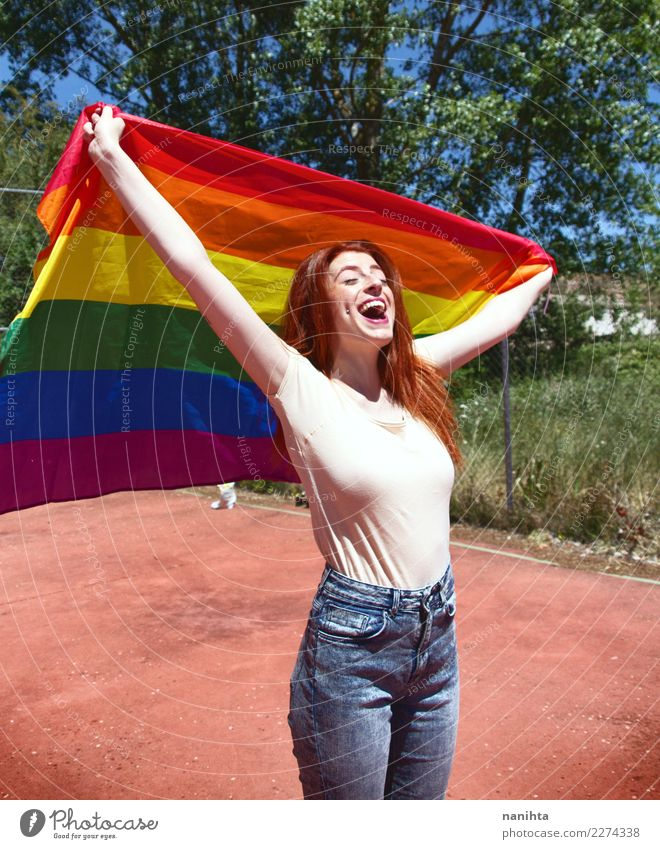 Young woman holding a rainbow flag Human being Nature Youth (Young adults) Summer Sun Joy 18 - 30 years Adults Life Lifestyle Spring Feminine Style Laughter