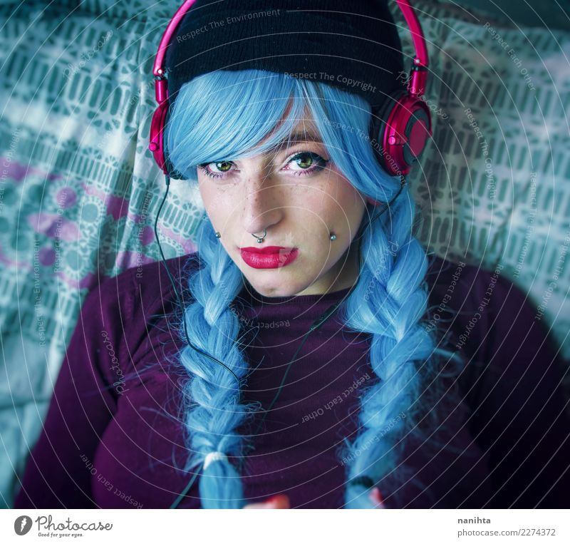 Young woman with blue hair is listening to music Human being Youth (Young adults) Blue Beautiful 18 - 30 years Face Adults Lifestyle Feminine Style Art
