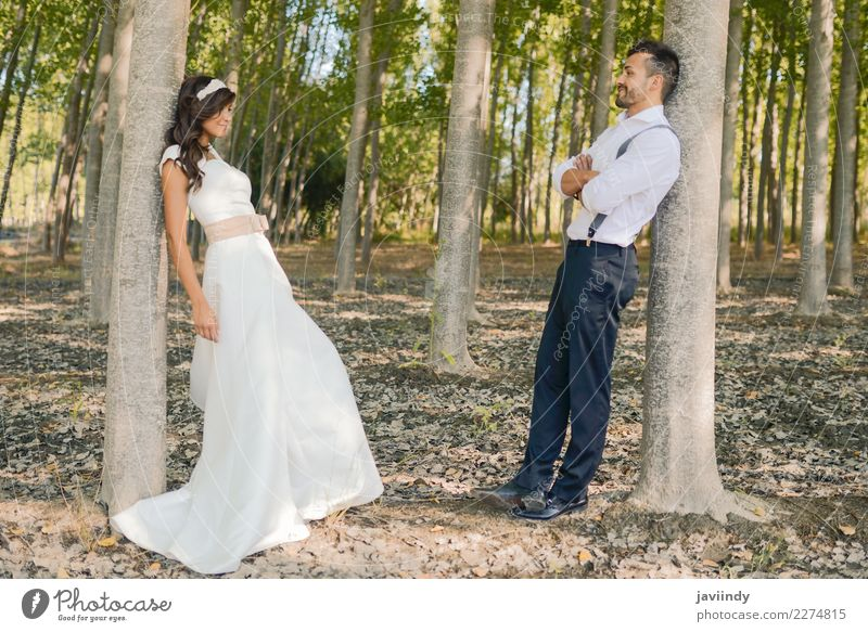 Just married couple together in nature background Happy Beautiful Feasts & Celebrations Wedding Human being Young woman Youth (Young adults) Young man Woman