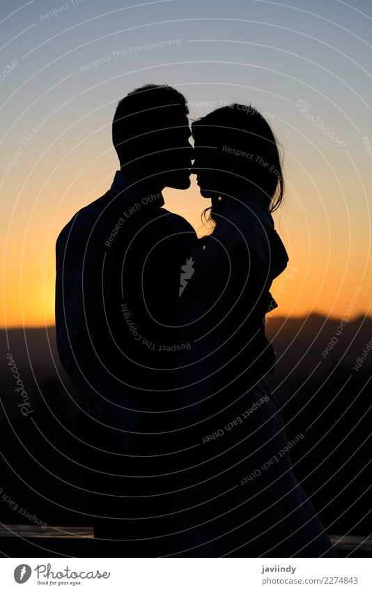 Silhouette of a young couple at Sunset Happy Beautiful Wedding Human being Young woman Youth (Young adults) Young man Woman Adults Man Couple 2 18 - 30 years