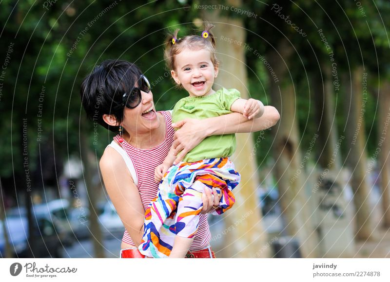 Mother and daughter laughing in urban park Joy Life Parenting Child Human being Feminine Baby Toddler Girl Young woman Youth (Young adults) Woman Adults Parents