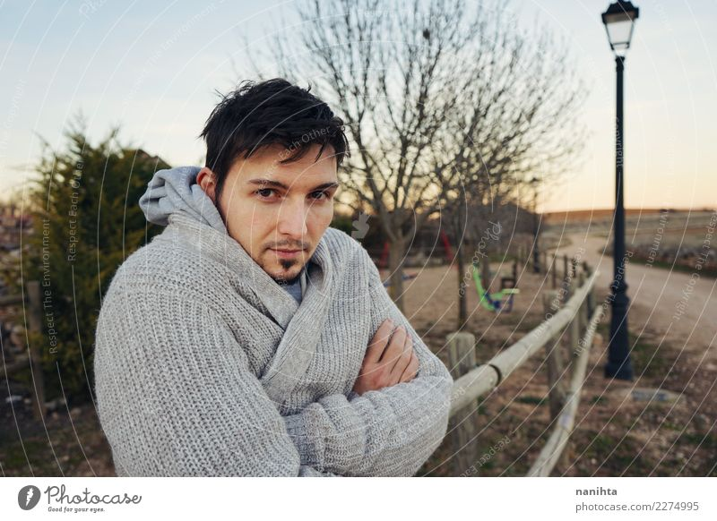 Young man posing outdoors Lifestyle Style Senses Relaxation Vacation & Travel Human being Masculine Youth (Young adults) Man Adults 1 30 - 45 years Environment