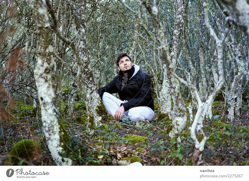 Young man into the forest Lifestyle Vacation & Travel Tourism Adventure Far-off places Freedom Expedition Winter vacation Hiking Human being Masculine