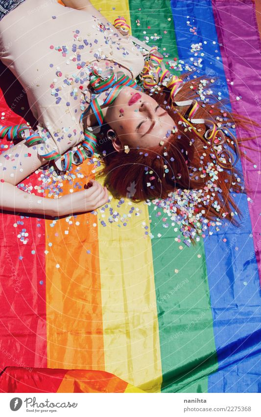 Young woman sleeping over a rainbow flag Lifestyle Style Design Beautiful Senses Relaxation Party Event Going out Feasts & Celebrations Human being Feminine