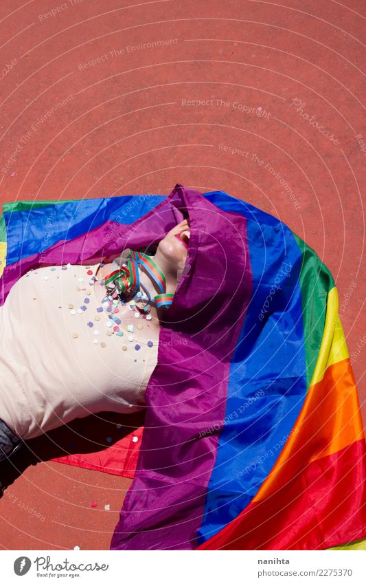 Young woman covered with a rainbow flag Lifestyle Design Joy Party Event Feasts & Celebrations Human being Feminine Homosexual Young man Youth (Young adults)