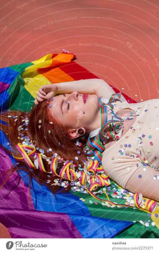 Young woman lying down over a rainbow flag Lifestyle Style Exotic Beautiful Hair and hairstyles Wellness Relaxation Calm Party Event Going out