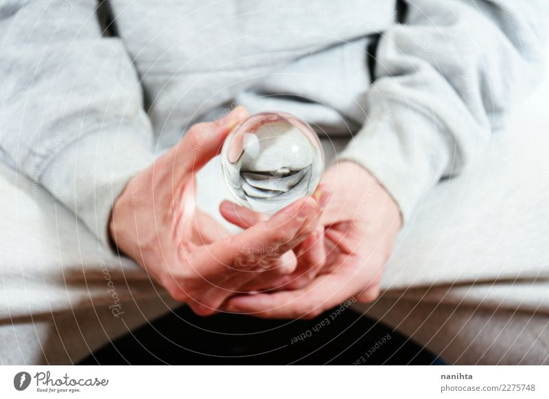 Man holding a crystal ball Human being Youth (Young adults) Young man Hand Red Adults Religion and faith Gray Design Contentment Masculine Glass Future
