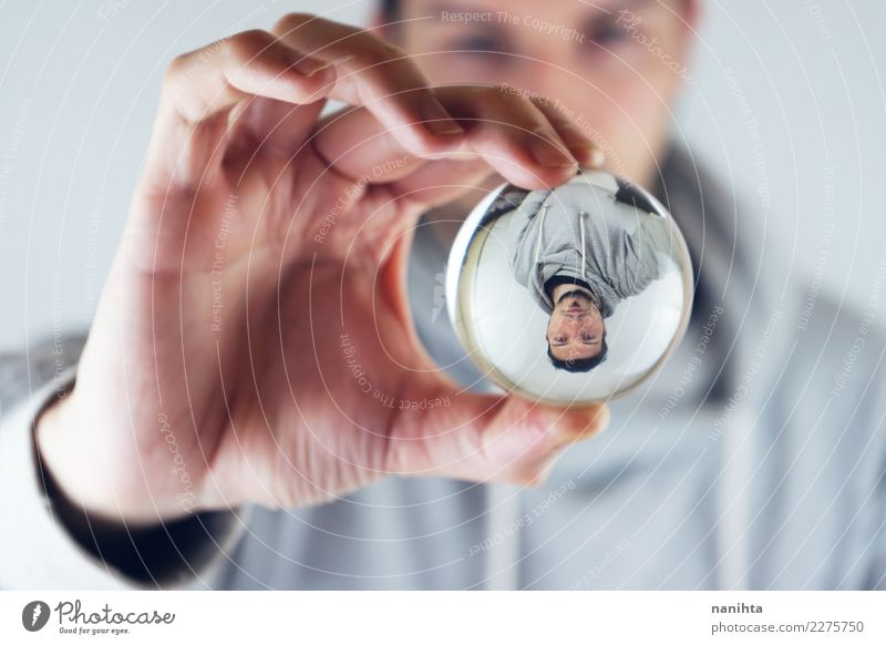 Young man viewed through a crystal ball Style Human being Masculine Youth (Young adults) Man Adults 30 - 45 years Sweater Black-haired Short-haired Facial hair