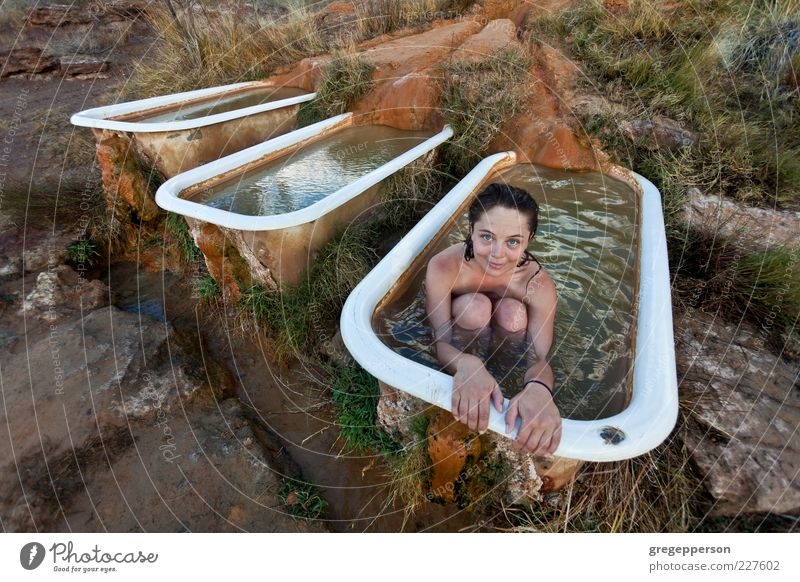 Young woman relaxing in a natural hot springs.. Human being Youth (Young adults) Adults Relaxation Swimming & Bathing 18 - 30 years Bathtub Woman Well-being