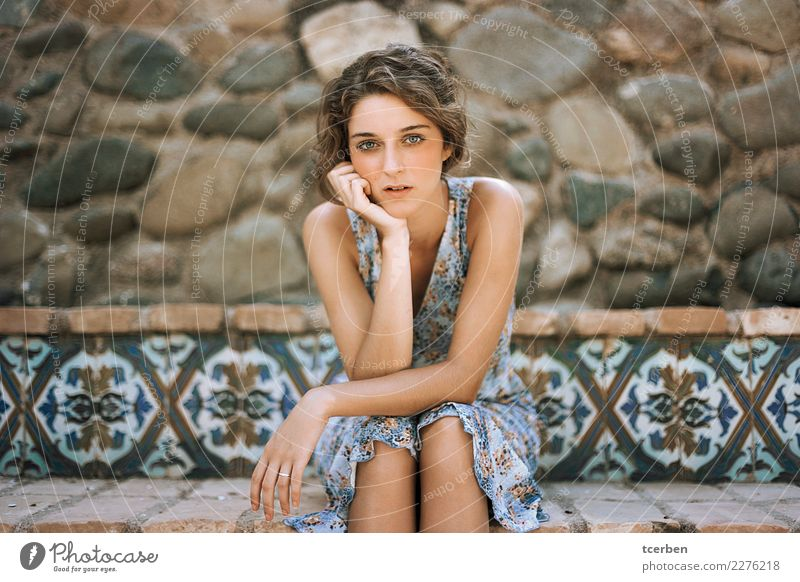 Portrait of young woman sitting on a stone bench Human being Youth (Young adults) Young woman Blue Summer Beautiful Calm 18 - 30 years Adults Wall (building)