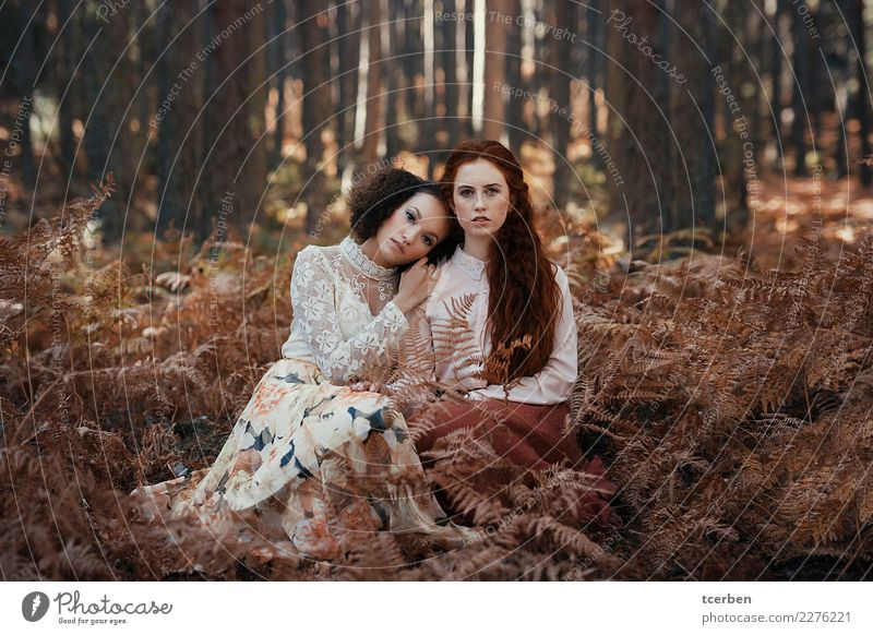 Two young women wearing vintage clothes sitting in the woods Human being Youth (Young adults) Young woman Beautiful White Tree Forest 18 - 30 years Adults Love