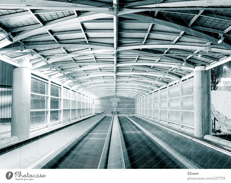 f Tunnel Manmade structures Architecture Stairs Means of transport Pedestrian Escalator Esthetic Dark Simple Elegant Gigantic Cold Modern Clean Blue Contentment