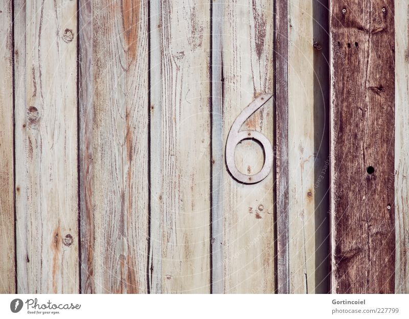 six Wood Digits and numbers Brown 6 Wood grain Joist Wooden wall House number Colour photo Exterior shot Copy Space left Shadow Deserted