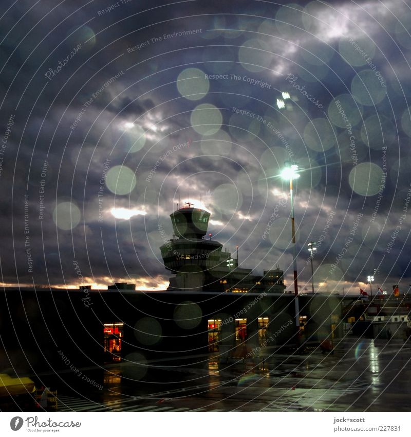 Otto Lilienthal is in the rain Drops of water Rain Airport Berlin-Tegel Airfield Air Traffic Control Tower Glittering Illuminate Dark Moody Lovesickness Longing