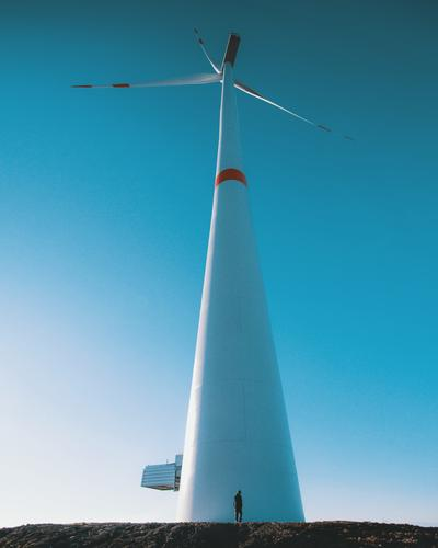 gigantic Technology Advancement Future High-tech Energy industry Renewable energy Wind energy plant Human being 1 Tall Small Dwarf Wide angle Pinwheel Windmill