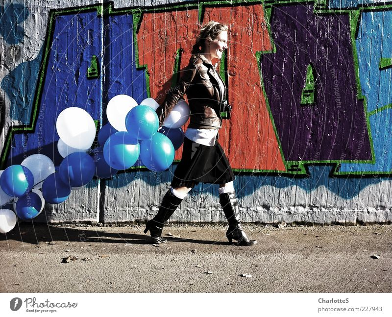 Youth (Young adults) Red Joy Feminine Wall (building) Graffiti Movement Laughter Lanes & trails Wall (barrier) Going Fashion Walking Concrete Modern Lifestyle