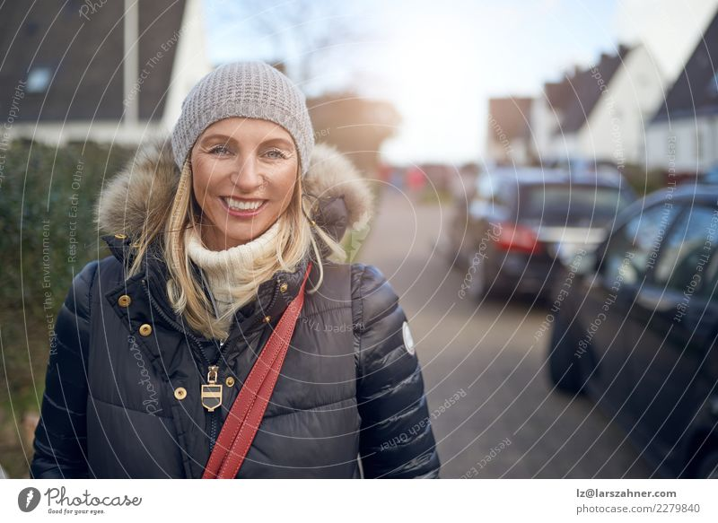 Smiling happy woman outdoors on a cold winter day Woman Human being Beautiful Winter Face Street Adults Autumn Happy Fashion Copy Space Leisure and hobbies
